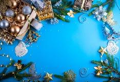 Украшения рождества на голубой предпосылке стоковая фотография rf
