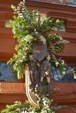 Украшения рождества на красной двери Стоковая Фотография