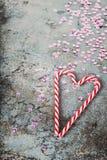 Украшения рождества - тросточки конфеты и sequins, тонизированное ретро Стоковое Фото