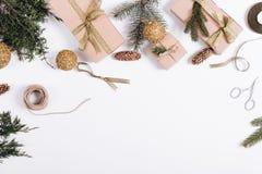 Украшения рождества на белой предпосылке: ветви ели, gi Стоковые Фотографии RF