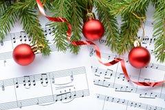 Украшения рождества на листах с примечаниями Стоковое Фото