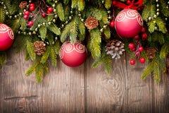 Украшения рождества над древесиной Стоковые Изображения RF