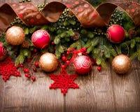 Украшения рождества над древесиной Стоковые Фотографии RF