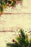 Украшения рождества с ветвью и снежинками ели Стоковое Фото