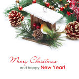 Украшения рождества - birdhouse, елевые ветви и сусаль Стоковые Изображения