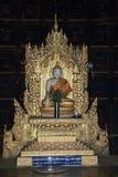 Украшенная буддийская статуя на монастыре Bagaya Стоковое фото RF