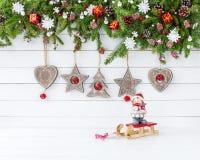 Украшенная ветвь ели рождества, украшение рождества деревянное скопируйте космос Стоковое Фото