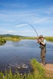 улавливает семг рыболова Стоковые Изображения