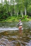 улавливает семг рыболова Стоковая Фотография