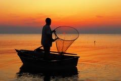 улавливает солнце рыболова Стоковая Фотография