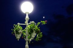 Street lamp with flowers classic motifs royalty free stock photos