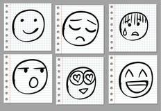 Улыбки Doodle нарисованные рукой на странице тетради вектор черный Стоковое Изображение RF