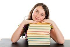 Умная девушка школы с стогом книг Стоковая Фотография