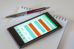 Умные телефон, ручка и блокнот Стоковые Изображения RF