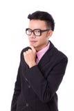 Умный бизнесмен с eyeglasses думая и смотря вы Стоковое Изображение