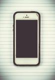 умный телефон на предпосылке блокнота иллюстрация штока