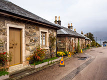 Уникально дома стиля на деревне Luss, Шотландии, Великобритании Стоковое фото RF