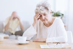 Унылая старшая женщина после ссоры Стоковое Фото