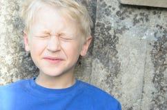 Унылая сторона мальчика попрошайки, эмоции Стоковые Изображения RF
