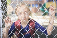Унылая девушка загородки Стоковая Фотография