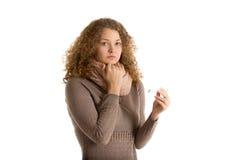 Унылая девушка с термометром смотрит в камере Стоковые Изображения