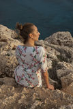 Унылая женщина заходом солнца стоковое фото rf