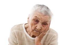 Унылая пожилая женщина Стоковая Фотография