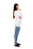 Унылая сиротливая молодая женщина сдерживая ее ноготь Стоковые Изображения