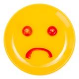 Унылая сторона smiley сделанная на плите Стоковая Фотография