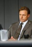 Унылый бизнесмен в офисе Стоковая Фотография