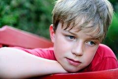 Унылый мальчик стоковая фотография