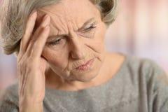 Унылый пожилая женщина стоковое изображение rf
