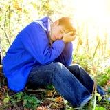 Унылый подросток напольный Стоковая Фотография RF