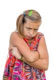 Унылый ребенок с сложенными руками Стоковое Изображение