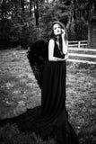 Упаденный ангел с черными крылами Стоковые Изображения