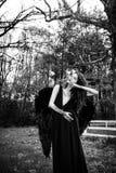Упаденный ангел с черными крылами Стоковые Фотографии RF