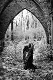 Упаденный ангел с черными крылами Стоковое фото RF