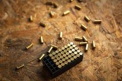 Упаковка пуль для винтовки и пустых пуль Стоковое Фото