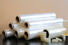 Упаковочные материалы: фильм простирания, клейкая лента, лента краски Стоковые Изображения