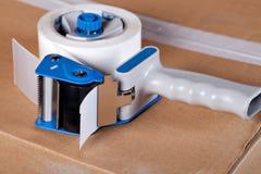 Упаковывая распределитель пушки ленты стоковые фотографии rf