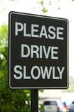 управляйте пожалуйста подпишите медленно Стоковые Изображения