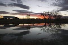 управлять тележкой захода солнца Стоковое Фото