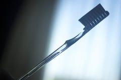 Управление металлической пластинкы гигиены зубной щетки зубоврачебное Стоковые Фотографии RF