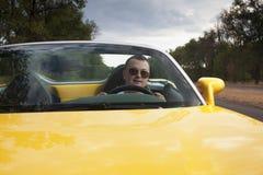 Управлять человека sportcar Стоковые Фотографии RF