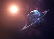 Уран с лунами от космоса показывая всем их Стоковые Изображения