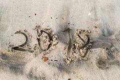 Уродские и топорные письма 2018 на песчаном пляже Стоковая Фотография