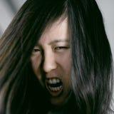 Уродский страшный азиатский кричать изверга женщины отчаянный Стоковое фото RF