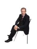 усаженный стул бизнесмена Стоковое Изображение RF