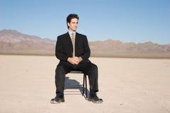 усаживание бизнесмена Стоковые Фотографии RF