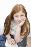 Усаживание девочка-подростка Стоковое Фото